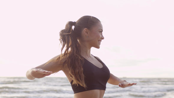 Girl is Doing Stretching at Morning in Beach