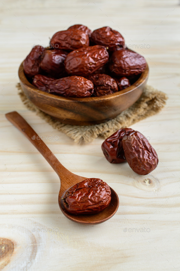 Dried jujube fruit on wooden table - Stock Photo - Images