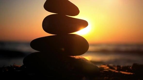 Stones Pyramid On Beach Symbolizing Zen Harmony