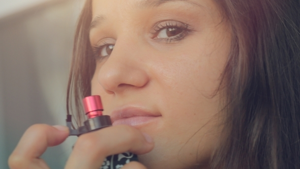 Young Beautiful Woman Testing The Fragrance
