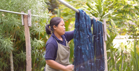 Woman Hanging Silk Thread