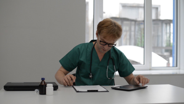 Doctor Working Using Tablet
