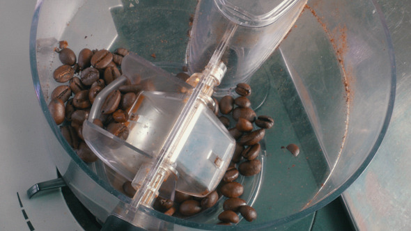 Coffee Beans Added to the Grinder