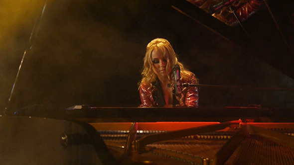 Woman Pianist Plays The Grand Piano