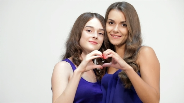 Sisters Showing Heart Shape Gesture