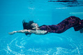 Beautiful woman girl dress underwater diving swim blue sunny day pool - PhotoDune Item for Sale