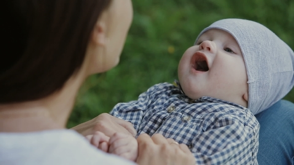 Happy Baby Boy Playing With Mother In The Park