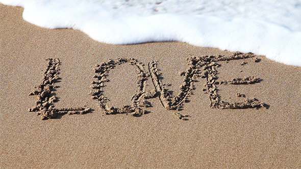 Word Love Drawn in The Sand