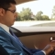 Businessman Sitting In The Car Reading Tablet - VideoHive Item for Sale