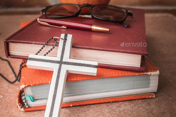 The cross against the book - Stock Photo - Images