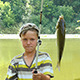 Young Caucasian Boy With Fishing Pole And Fish - VideoHive Item for Sale