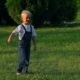 Elementary Aged Boy Kicking Ball In The Field - VideoHive Item for Sale