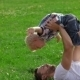Father And Son Playing On The Grass In Park - VideoHive Item for Sale
