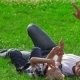 Father And Son Dreaming On The Grass In Park - VideoHive Item for Sale