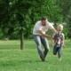 Happy Father And Son Playing Outdoors - VideoHive Item for Sale