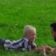 Father And Son Lying On The Grass In Park - VideoHive Item for Sale