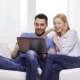 Happy Couple With Laptop Computer At Home - VideoHive Item for Sale