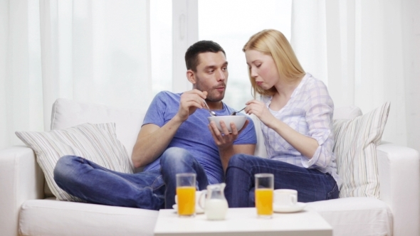 Happy Couple Having Breakfast At Home