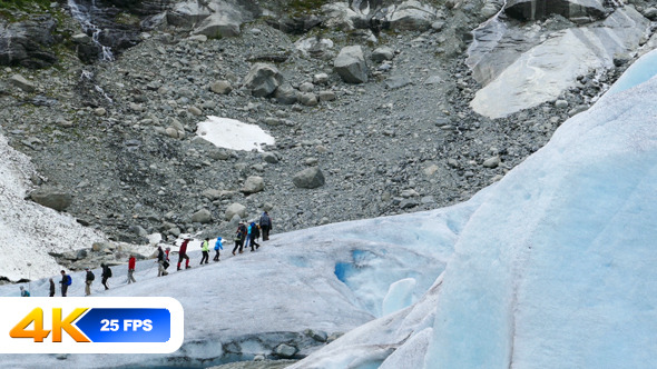 People Hiking Over Glacier