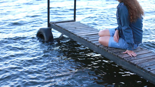 Girl on the Sea Sitting on the Pier