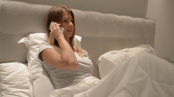 Girl Talking on Phone in Bed 2