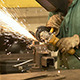 Welder Working with an Industrial Grinder - VideoHive Item for Sale