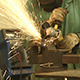 Sparks Flying from a Metal Grinder in Welding Shop - VideoHive Item for Sale