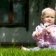 Seven Month Baby Plays On a Lawn With a Flower - VideoHive Item for Sale