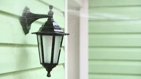 Jet Of Water Washing Street Lamp