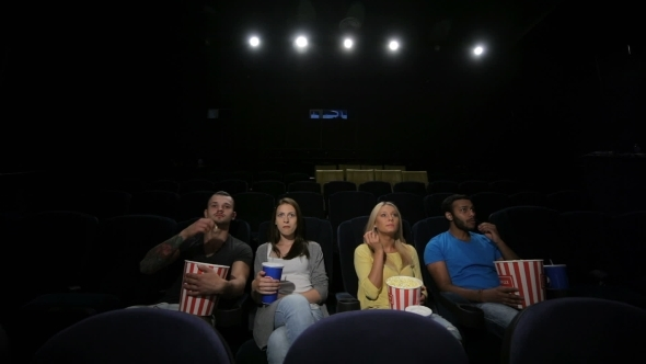 Group Of Friends Wathing Film In Cinema