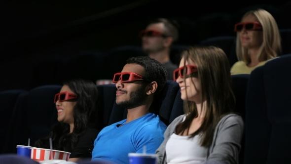 Group Of Friends Watching Film In Cinema