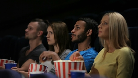 Group Of Friends Watching Film In Cinema