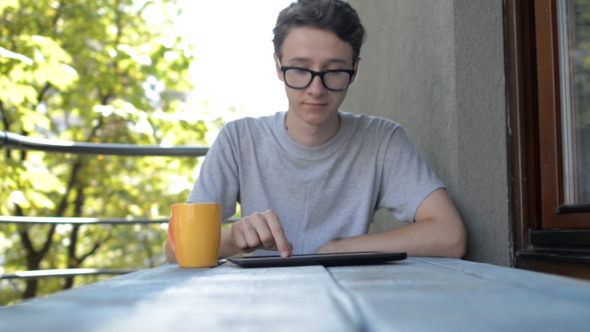 Young Man Using Tablet
