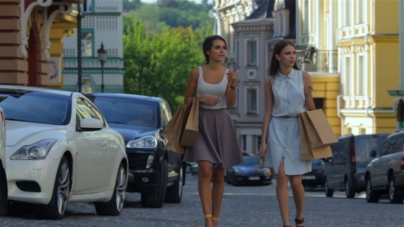 Girls Holding Shopping Bags And Walk