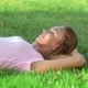 Beautiful Athlete Resting On The Green Grass - VideoHive Item for Sale