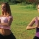 Two Beautiful Girls Doing Yoga In The Park - VideoHive Item for Sale