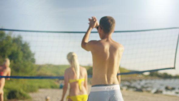 Young People are Playing in Beach Volleyball