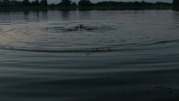 Man Bathes In The Lake