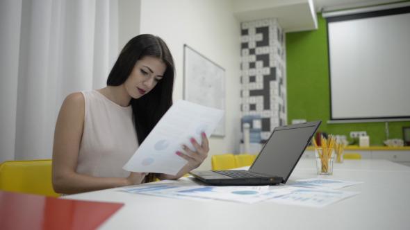 Girl Going Through Financial Report
