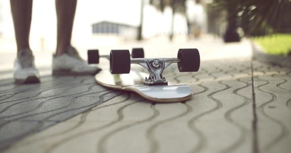 Longboard In Upside Down On a Concrete Ground