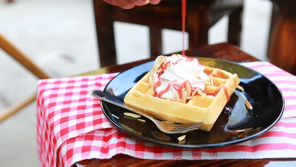 Put Strawberry Syrup On Wafer Whip Cream