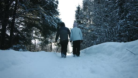 Lovely Couple Walking And Holding Hands During Beautiful Day Of Winter