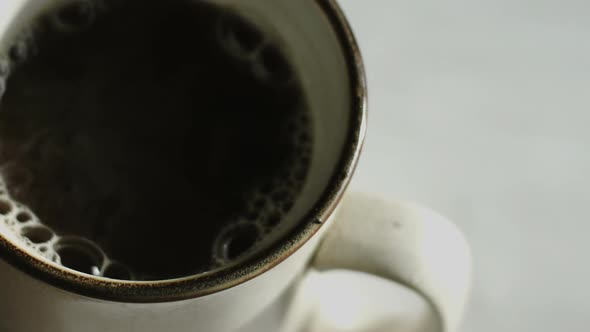 Extreme Closeup Of Pourring Hot Water For Instant Coffee