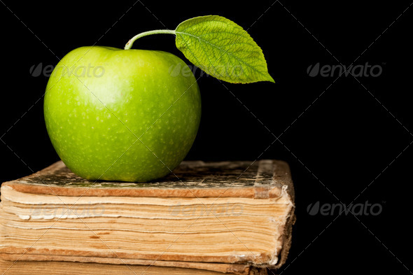 Green apple on book isolated - Stock Photo - Images