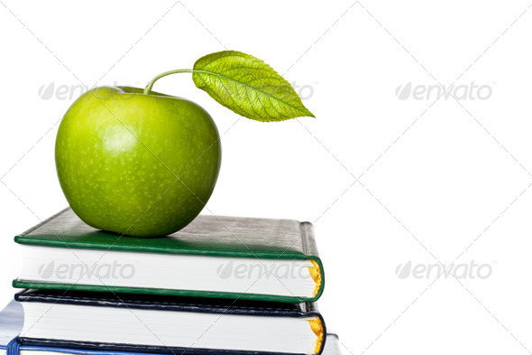 Green apple on textbook isolated - Stock Photo - Images
