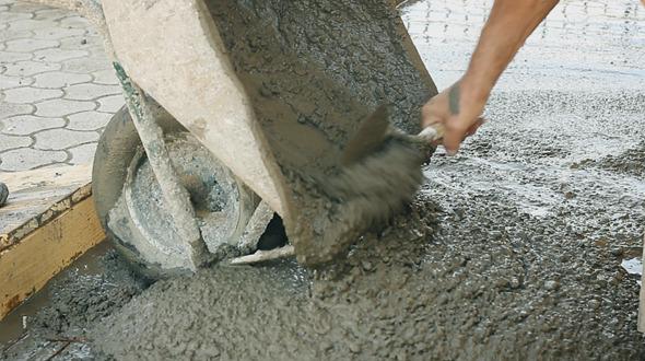 Construction Worker Empty Out Wheelbarrow
