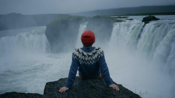 Wool Sweater On Edge Of Waterfall Rock