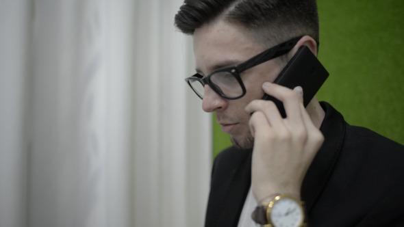 Man Face Talking on Phone