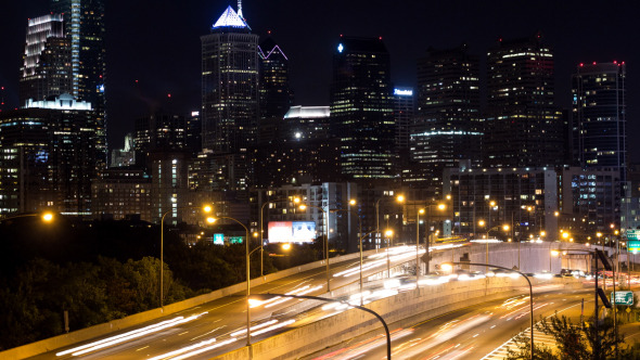 Night Highway Traffic Against Philadelphia Skyline