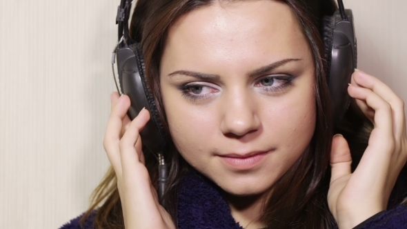 Girl Bathrobe With Headphones
